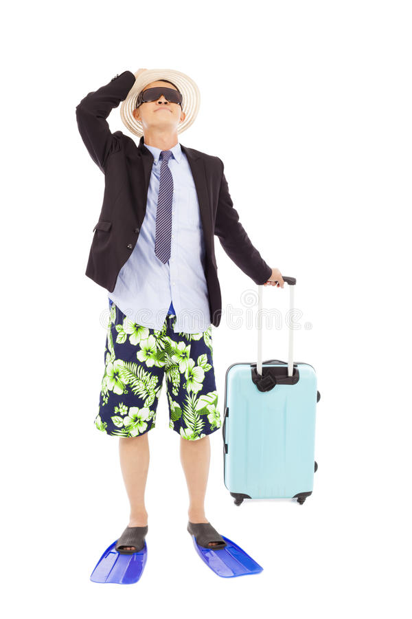 El hombre de negocios que sostiene equipaje y alista para ir en la vocación imagenes de archivo