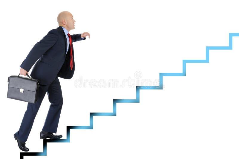 El hombre de negocios se ejecuta encima de la escala de la carrera imagen de archivo