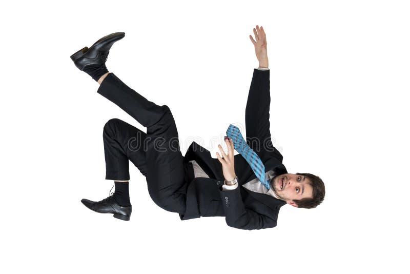 El hombre de negocios se está cayendo abajo Aislado en el fondo blanco imagen de archivo libre de regalías