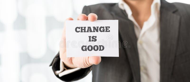 El hombre de negocios Showing Card con el cambio es buenos textos foto de archivo libre de regalías