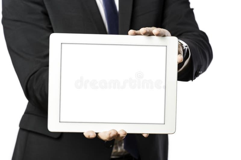 El hombre de negocios sostiene un ordenador de la tableta foto de archivo libre de regalías