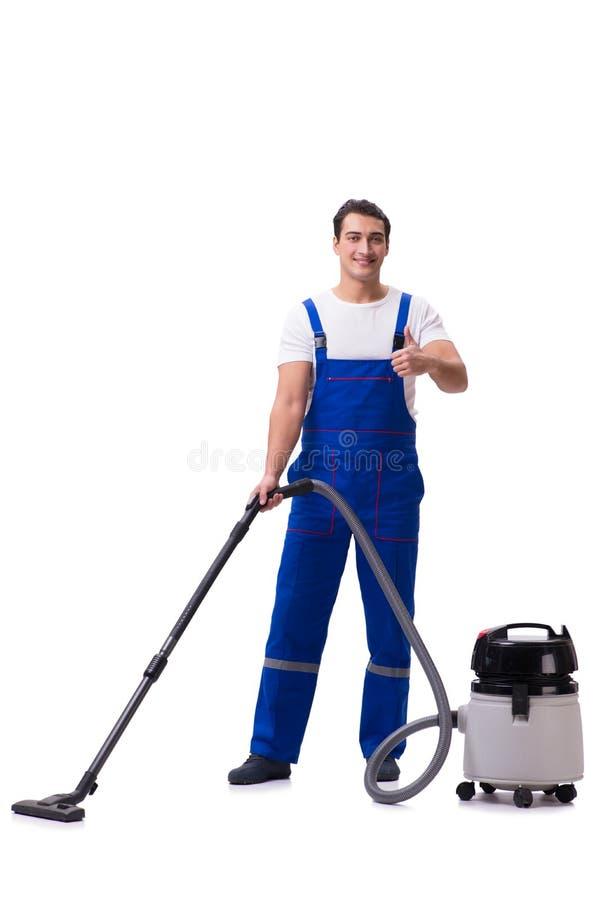 El hombre en las batas que hacen la limpieza del vacío en blanco imagenes de archivo