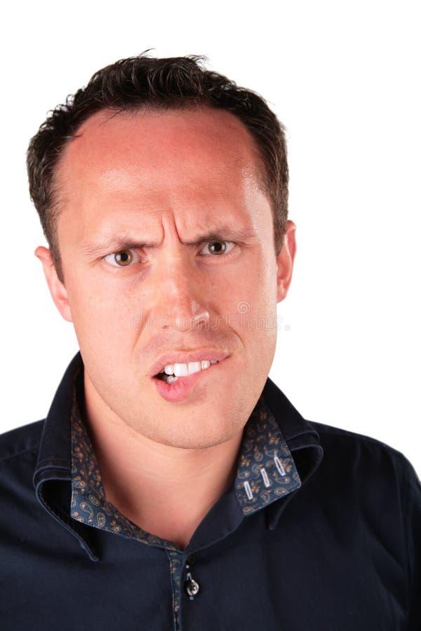 El hombre enojado muerde su labio imágenes de archivo libres de regalías