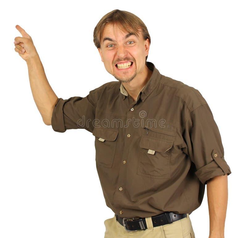 El hombre enojado señala por su mano en el tablero detrás de él fotografía de archivo libre de regalías
