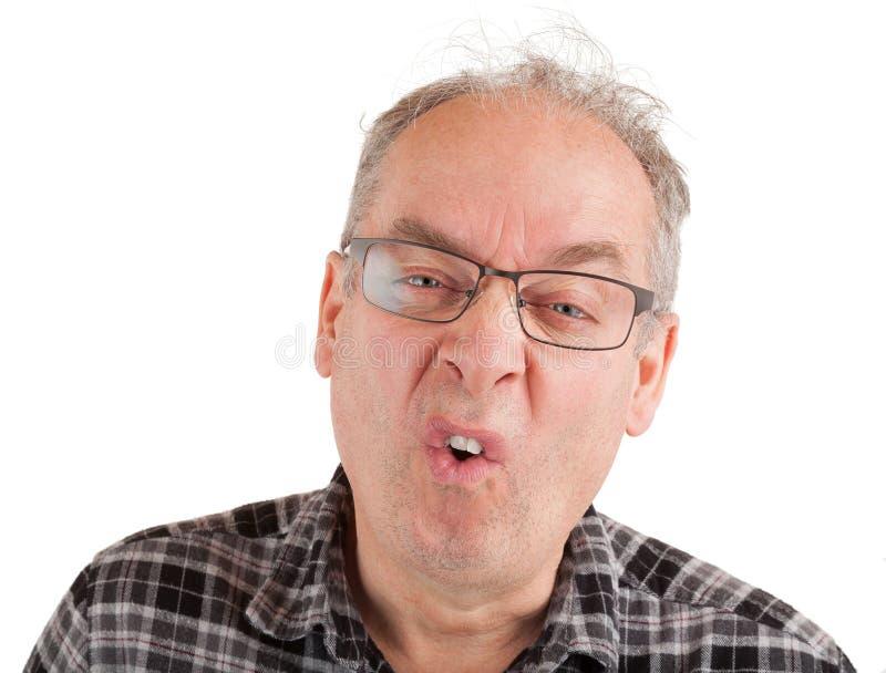 El hombre es hipercrítico sobre algo foto de archivo libre de regalías