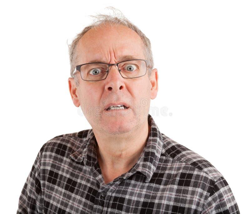 El hombre está contrariedad sobre algo fotografía de archivo