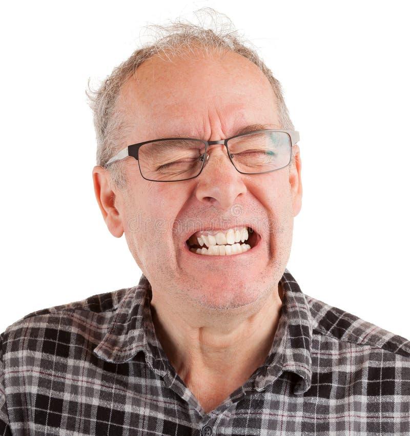 El hombre está en dolor imagen de archivo libre de regalías