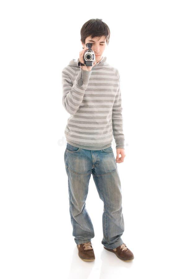 El hombre joven con el videocámera aislado fotos de archivo libres de regalías