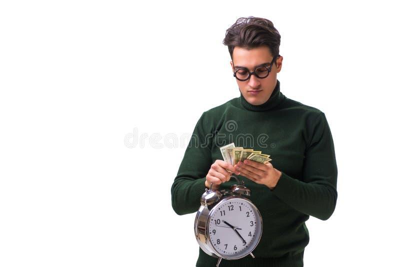 El hombre joven del empollón con el reloj y el dinero aislados en blanco foto de archivo