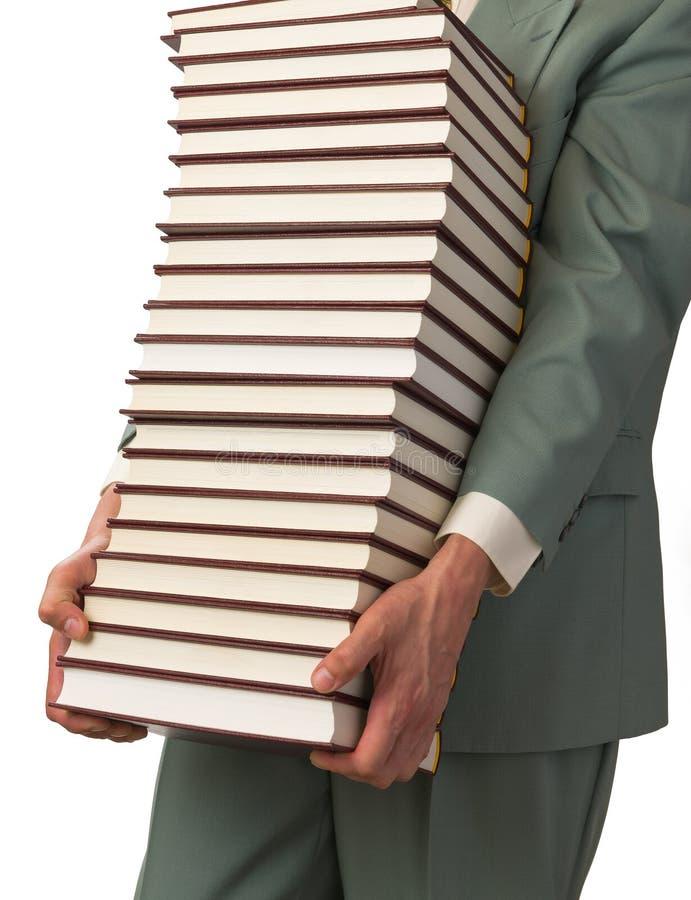 El hombre lleva los libros fotografía de archivo