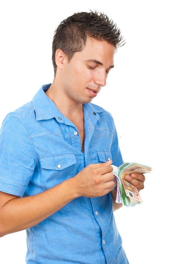 El hombre rico cuenta su dinero imagen de archivo