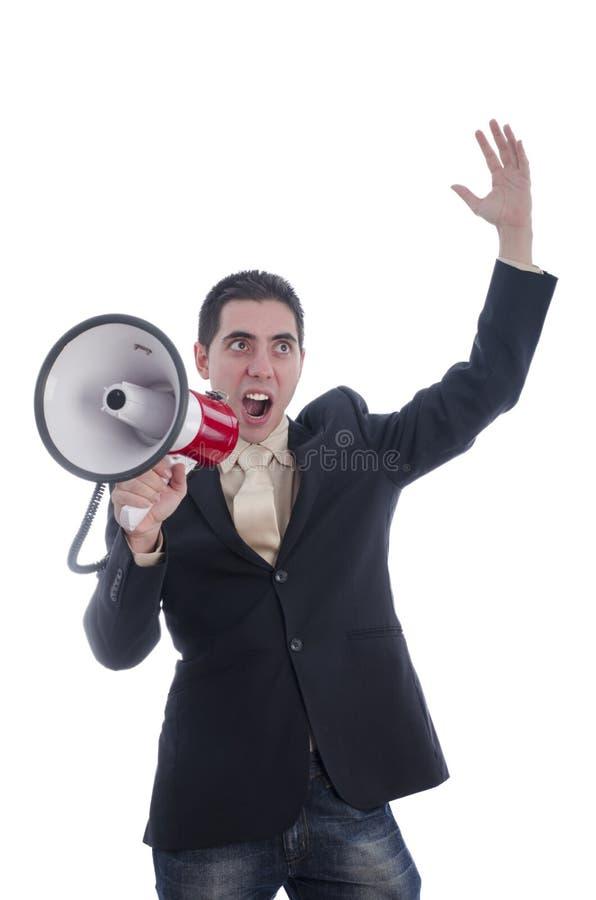 El hombre se vistió en traje que gritaba con la cara limpiada con un chorro de agua a través del megáfono imagen de archivo