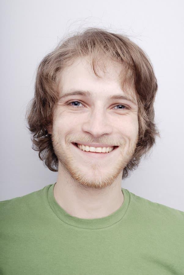 El hombre sonriente imagen de archivo