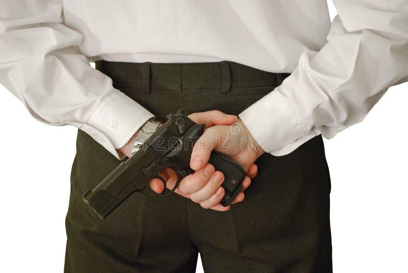 El hombre sostiene la arma de mano imágenes de archivo libres de regalías