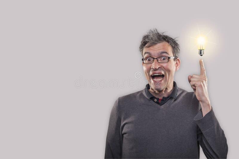 El hombre tiene una idea del genio imagen de archivo libre de regalías
