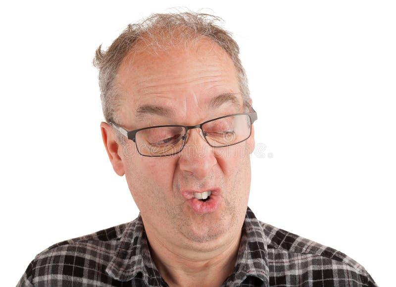 El hombre tiene una mirada quisquillosa fotos de archivo libres de regalías