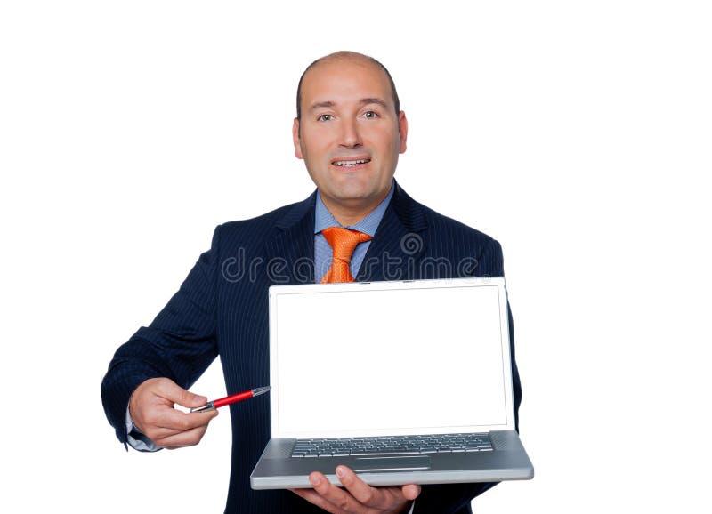 Encargado aislado en el fondo blanco indicado con el ordenador portátil M de la pluma fotografía de archivo libre de regalías