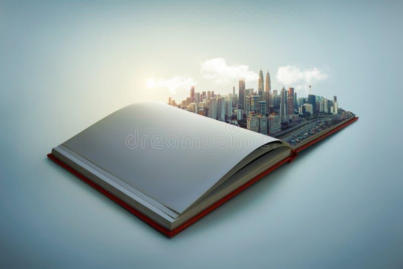 El horizonte moderno de la ciudad surge en las páginas abiertas del libro foto de archivo