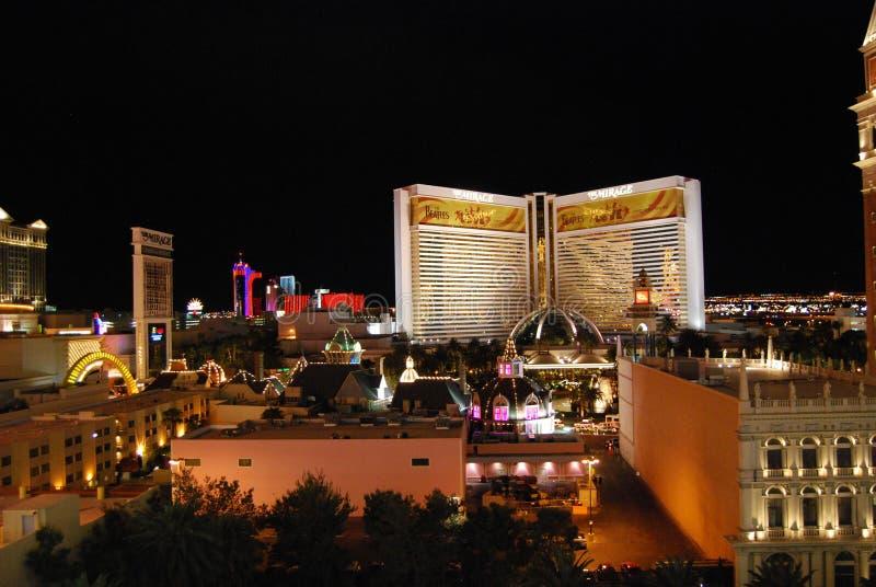 El hotel y el casino, la zona veneciana, metropolitana, ciudad, noche, señal del espejismo fotografía de archivo