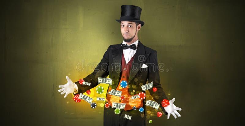 El ilusionista conjura con sus personales de juego de la mano foto de archivo libre de regalías