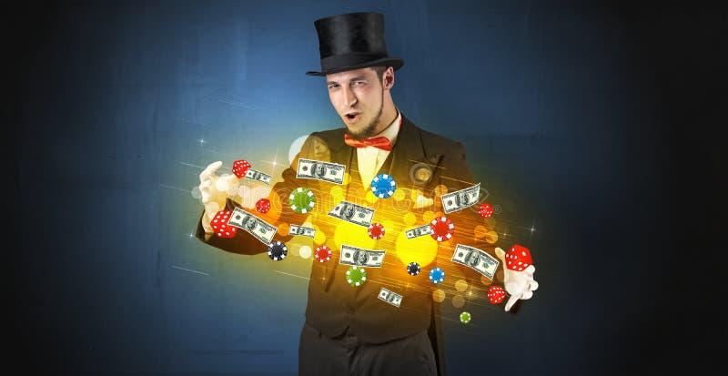 El ilusionista conjura con sus personales de juego de la mano imagenes de archivo