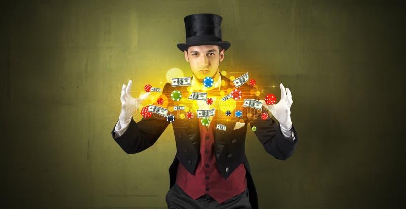 El ilusionista conjura con sus personales de juego de la mano imagen de archivo