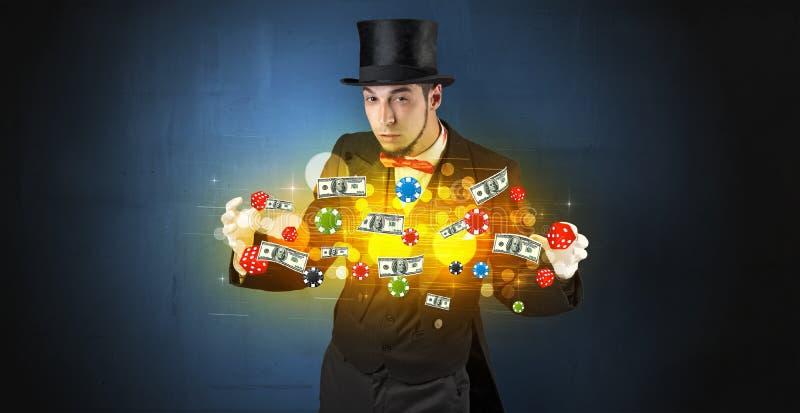 El ilusionista conjura con sus personales de juego de la mano fotos de archivo