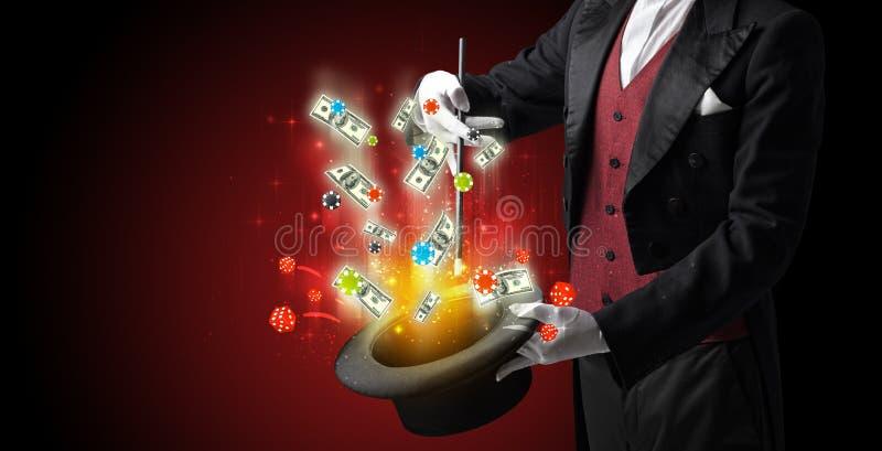 El ilusionista conjura suerte de un cilindro imagen de archivo libre de regalías