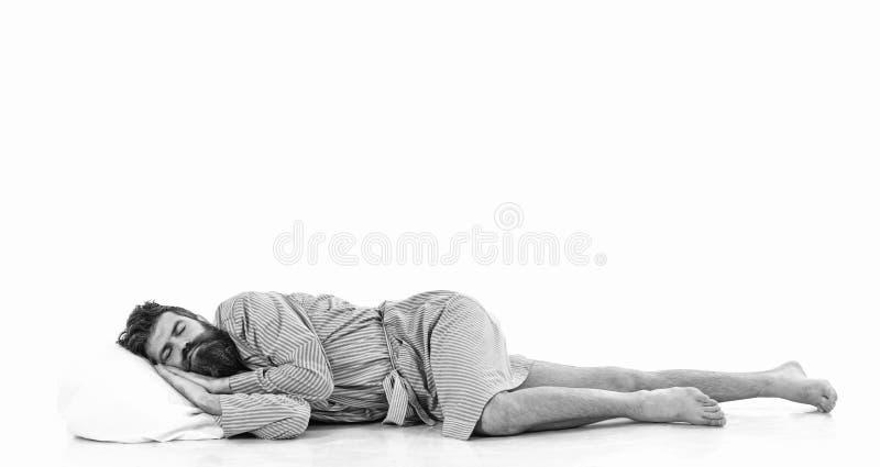 El inconformista con la cara soñolienta miente en la almohada, foto de archivo