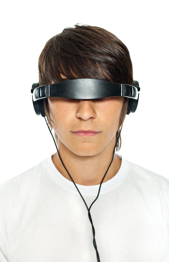 El individuo en auriculares fotografía de archivo libre de regalías