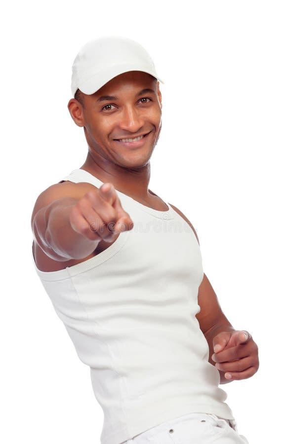 El individuo hermoso se vistió en señalar blanco en la cámara con su finger foto de archivo