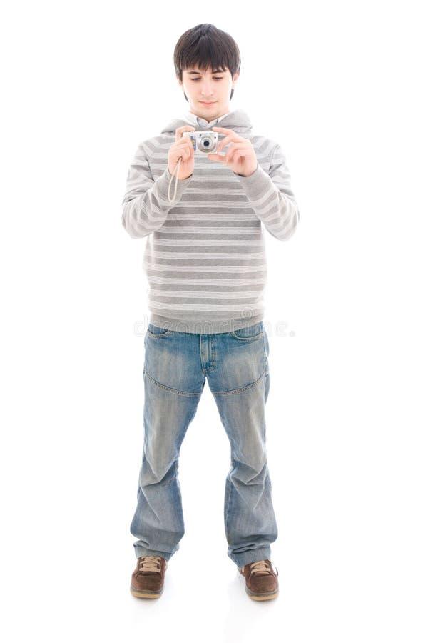El individuo joven con la cámara aislada en un blanco fotografía de archivo libre de regalías