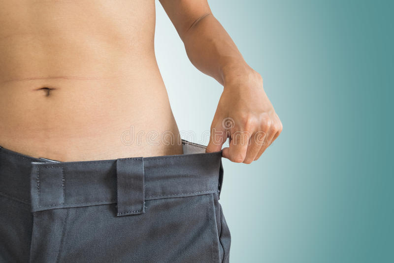 El individuo suelta su peso, forma de vida de la dieta sana fotos de archivo libres de regalías