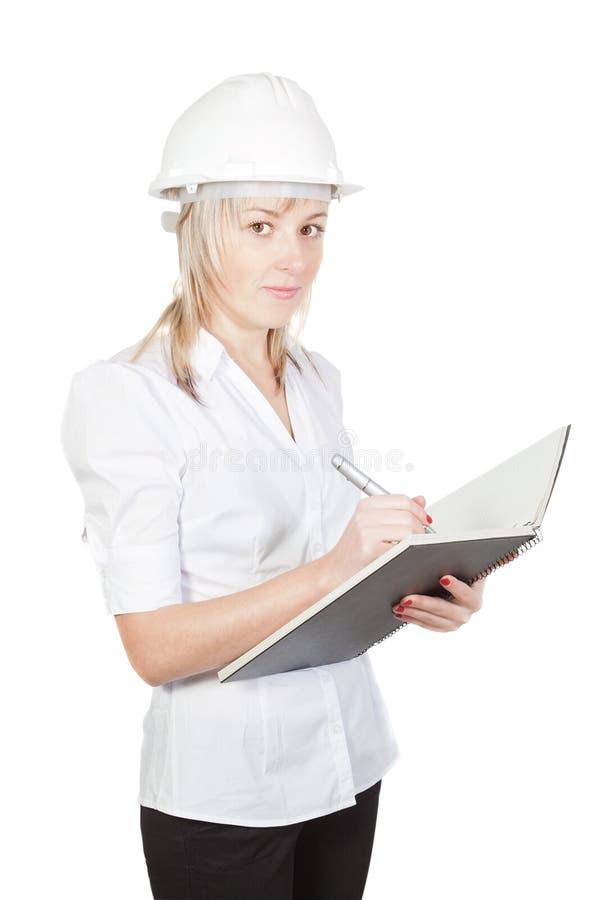 El ingeniero hermoso del arquitecto de la muchacha toma notas. imágenes de archivo libres de regalías