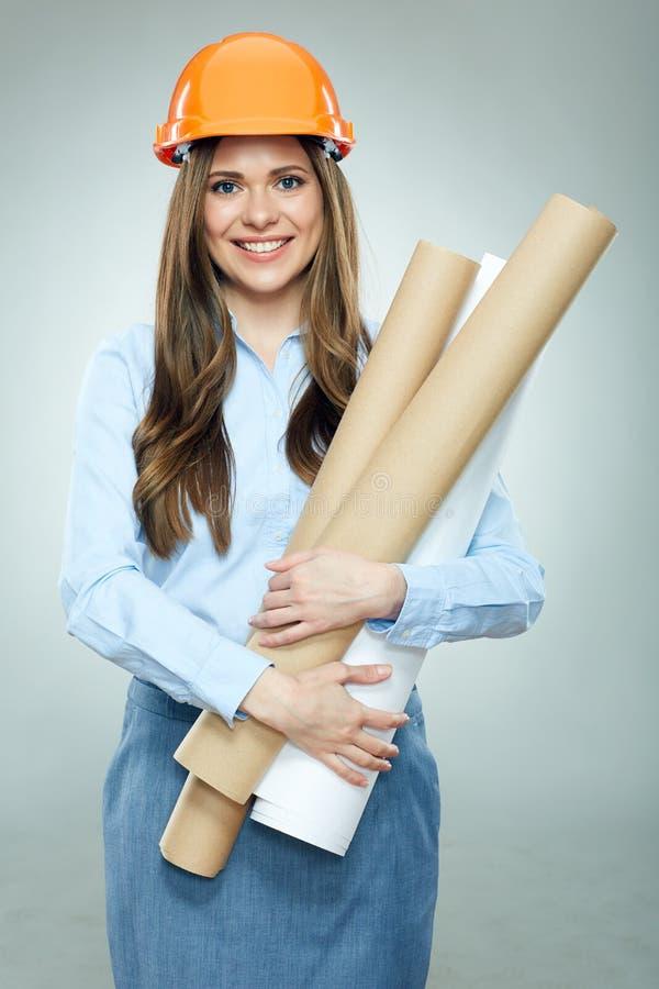 El ingeniero joven de la mujer de negocios, tenencia del arquitecto rodó encima de techn foto de archivo libre de regalías