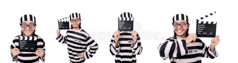 El interno divertido de la prisión con el tablero de la película aislado en blanco fotografía de archivo