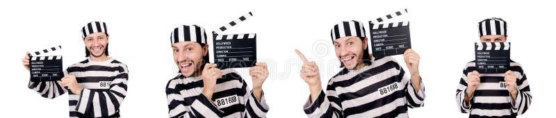El interno divertido de la prisión con el tablero de la película aislado en blanco imagen de archivo libre de regalías