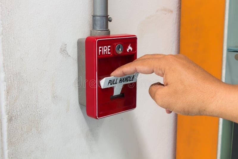 El interruptor la alarma de incendio de la manija del tirón foto de archivo libre de regalías