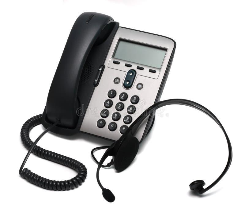 El IP telefona y un receptor de cabeza aislado en blanco fotos de archivo libres de regalías