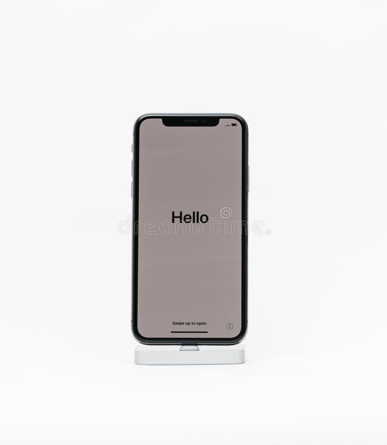 El iPhone X de Apple aisló el fondo blanco con hola palabra en Fren imagenes de archivo