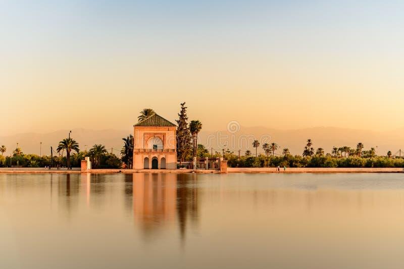 El Jardin de la Menara, Marrakech, Marruecos. Sunset in El Jardin de la Menara, Marrakech, Marruecos royalty free stock photo