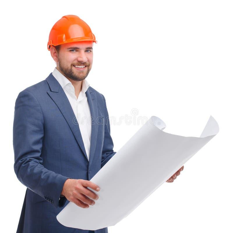 El jefe con una sonrisa sostiene un Whatman desplegado en sus manos en un fondo aislado blanco imagen de archivo