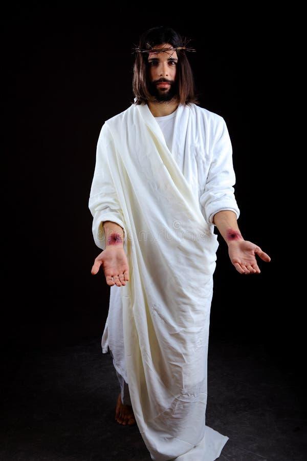 El Jesucristo resucitado que alcanza hacia fuera fotos de archivo libres de regalías