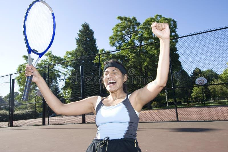 El jugador de tenis celebra fotografía de archivo