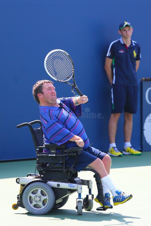 El jugador de tenis Nicholas Taylor de Estados Unidos durante el patio 2014 de la silla de ruedas del US Open escoge el partido foto de archivo
