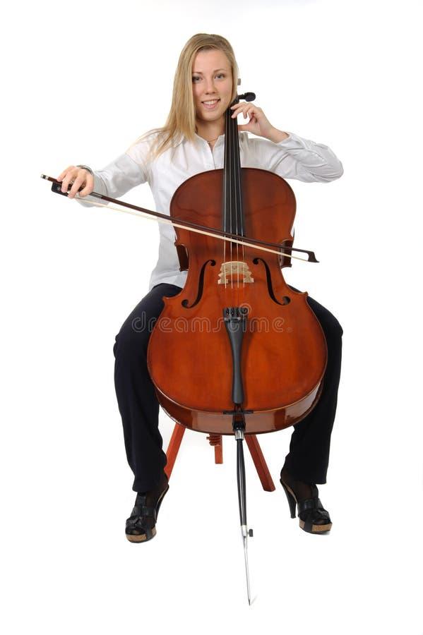 El jugar joven del violoncelista foto de archivo