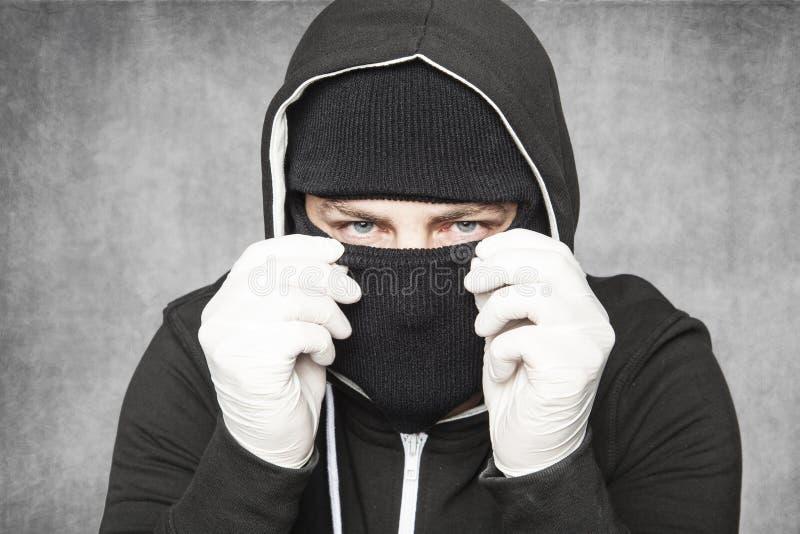 El ladrón es un barrendero de la chimenea imagenes de archivo