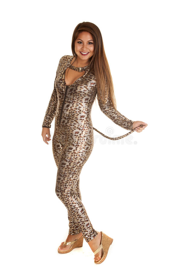 El leopardo de la mujer salta el traje del traje fotos de archivo