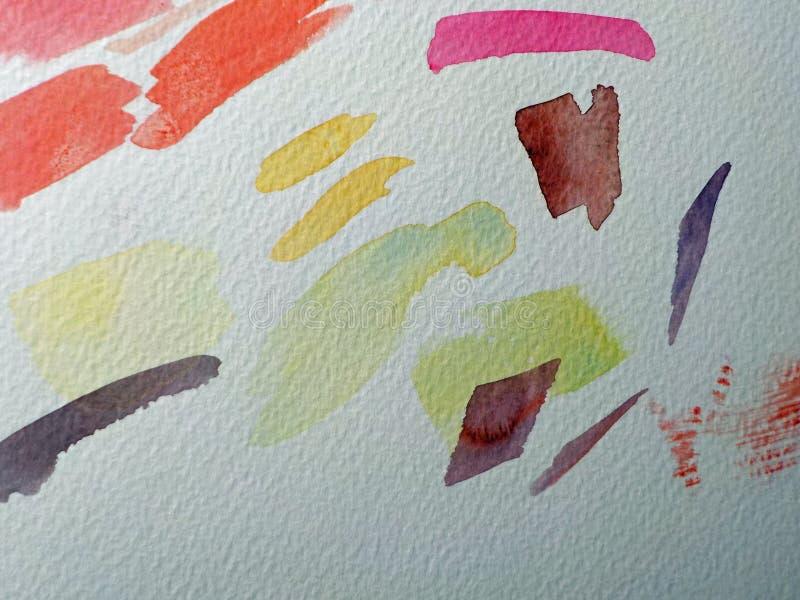 El Libro Blanco con los movimientos coloreados del cepillo pintó encendido fotos de archivo libres de regalías
