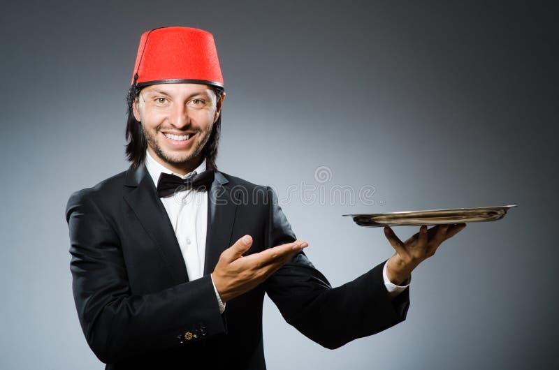 El llevar del camarero tradicional imagen de archivo